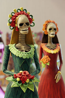 Day of the Dead figurines, via Wikipedia