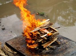 Cremation on the Bagamati, Hindu cremation, via Wikimedia Commons