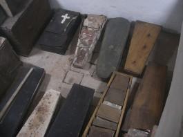 Children's coffins, note most have anthropoid shape, via Flickr user Quinet