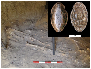 "Photo via Binder et al. 2014 ""Skeleton Sk244-8 in its original burial position in the western chamber of G244. The insert shows faience amulet F9273 found associated with the individual from both sides. The Egyptian god Bes (right side) is depicted on the reverse side.""  doi:10.1371/journal.pone.0090924.g002"