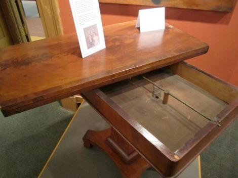 "The ""table that could talk"" at the Rochester Historical Society, showing the interior springs and rod that produced the rapping, via Atlas Obscura"
