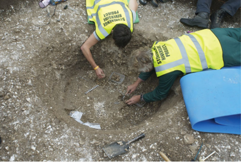 Cremated human remains being excavated from the base of Aubrey Hole 7 by Jacqui McKinley and Julian Richards. The bone fragments were deposited in this re-opened pit in 1935 (photograph: Mike Pitts, from Willis et al. 2016)